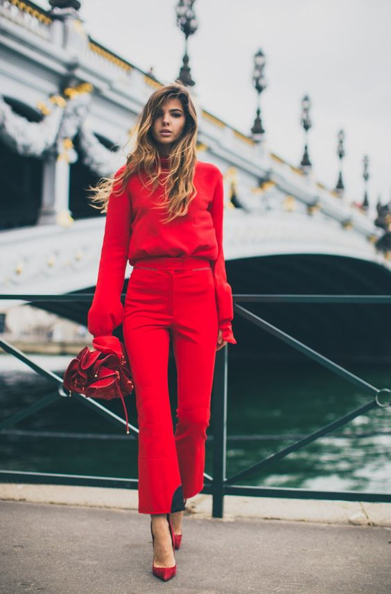 a red sweater with a turtleneck and matching cropped pants plus red shoes
