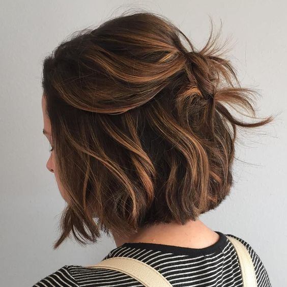 a wavy brown bob with caramel balayage is a fashionable way to wear a bob