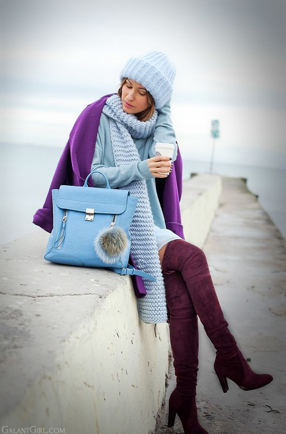 an ultraviolet coat, a powder blue beanie, scarf, tall burgundy boots and a light blue bag