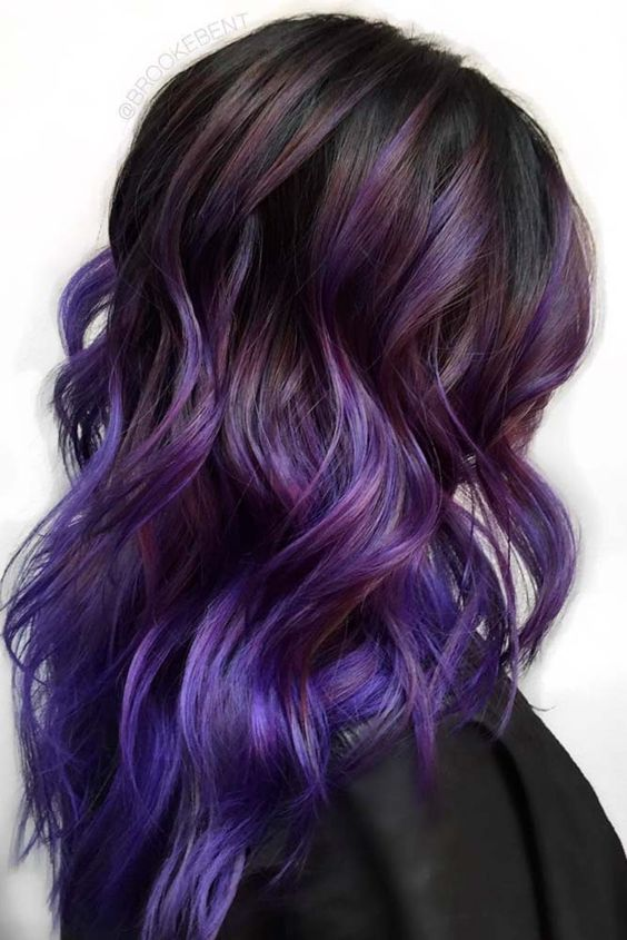 black hair with purple to ultraviolet balayage is a bold and trendy idea