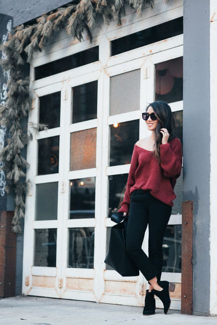 black skinnies, black chelsea boots, a red one shoulder sweater