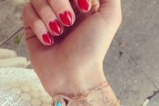 06 bold red heart manicure with a large heart on each finger
