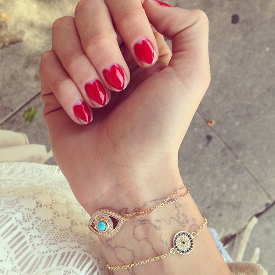 bold red heart manicure with a large heart on each finger