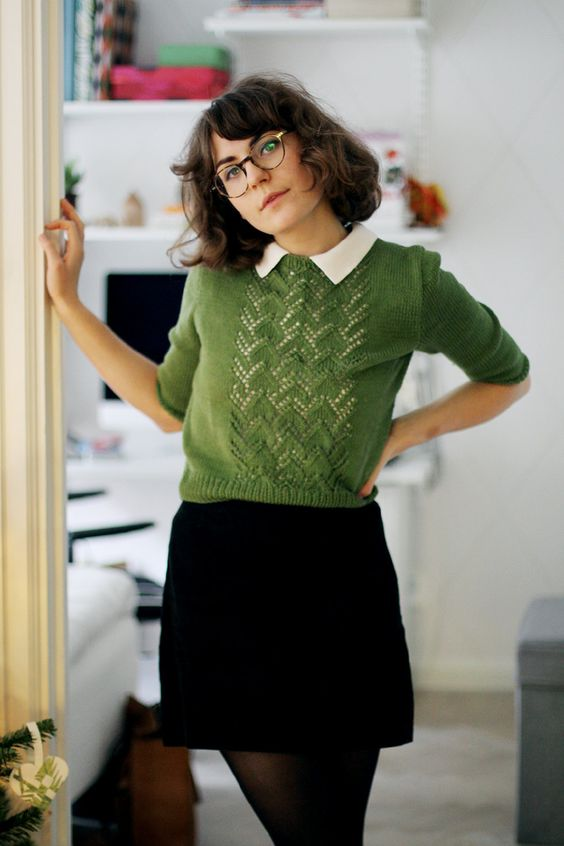 a black velvet mini, a white shirt and a green pullover for an everyday work or college look