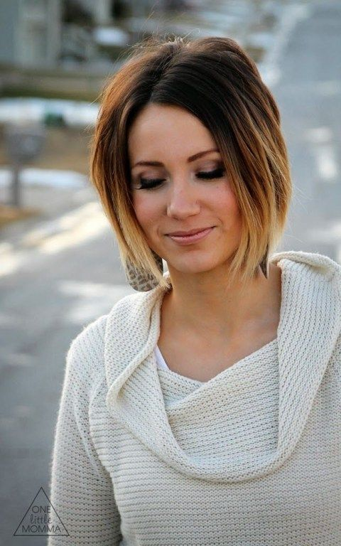 a short asymmetrical bob, dark brown roots and blonde ombre