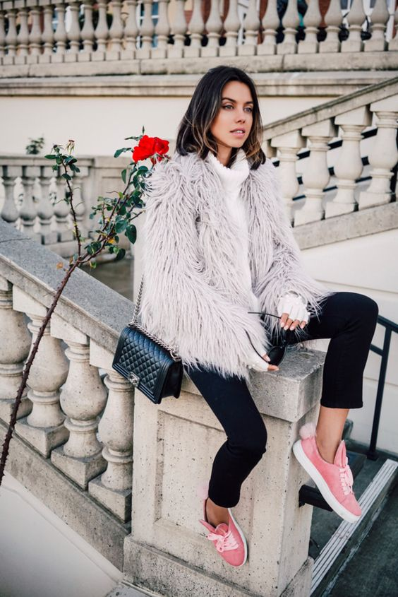 black cropped pants, a white sweater, a fuzzy faux fur coat and pink sneakers
