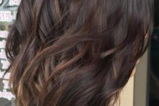 07 dark plum wavy hair with subtle bronde balayage to make the look more eye-catchy