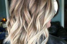07 light brown wavy and layered hair with blonde balayage looks chic and fun