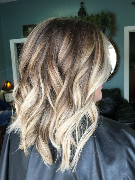 Picture Of Light Brown Wavy And Layered Hair With Blonde Balayage