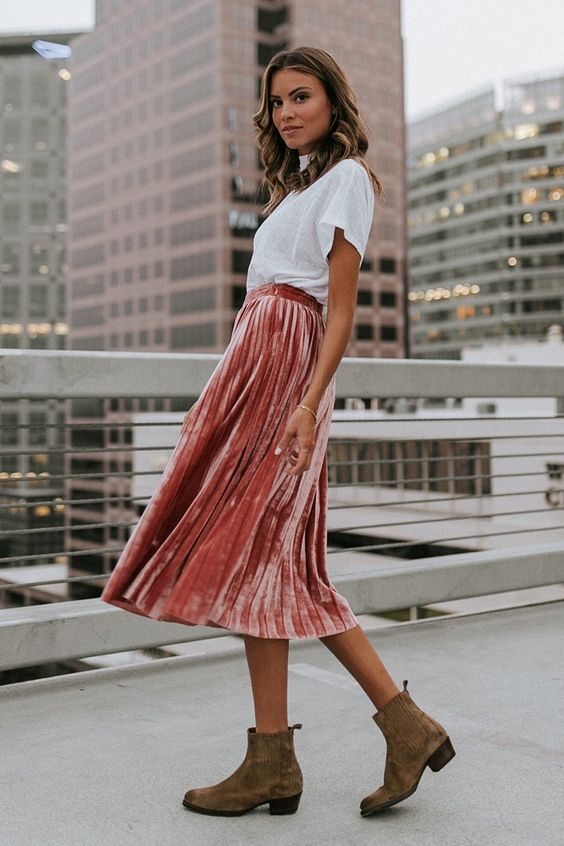 a white tee, a peachy pink velvet pleated midi skirt and tan chelsea boots