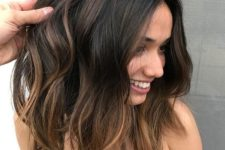 08 dark hair with subtle bronde balayage and messy waves is one of the hottest trends