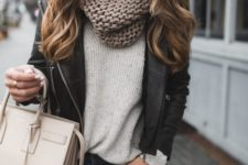 08 jeans, a neutral sweater, a chunky knit scarf and a black leather jacket