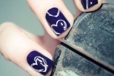 08 navy nails with white nail polish hearts for a bold and cute look