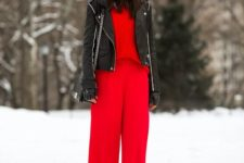 08 red wide pants, a red sweater, a black leather jacket and an embellished beanie