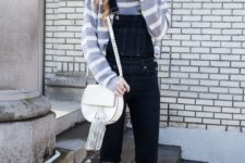 09 a dark denim overall with ripped parts, a striped top, brown booties and a neutral bag