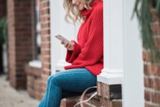 09 a red chunky knit sweater, blue skinnies, white sneakers and a blush bag