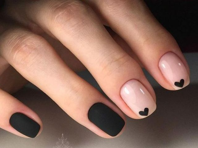 blush nails with little black hearts and matte black nails for an elegant look
