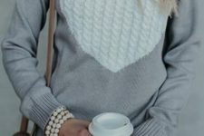 10 a grey heart cable knit sweater, ripped denim, a pearl bracelet and a bag