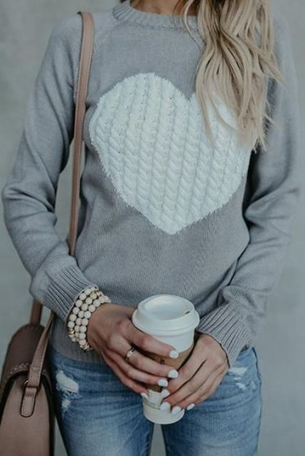 a grey heart cable knit sweater, ripped denim, a pearl bracelet and a bag