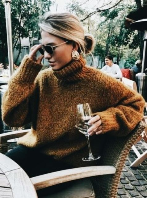 a messy low bun is comfy to wear with a sweater or even a large scarf