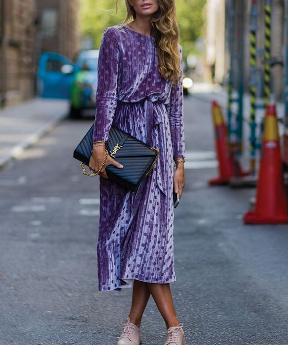 a violet polka dot velvet midi dress worn with blush sneakers for a girlish every day look
