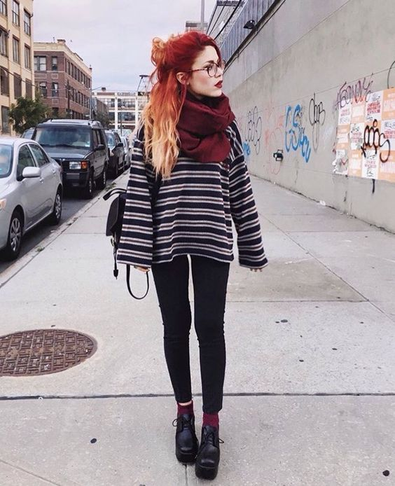 black skinnies, a striped oversized sweater, black shoes and a plum colored scarf