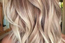 10 blonde balayage on wavy layered chestnut hair is a cute and girlish idea