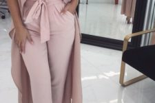 10 high waisted blush pants, a white strapless sweetheart neckline top, a long blush vest and nude heels