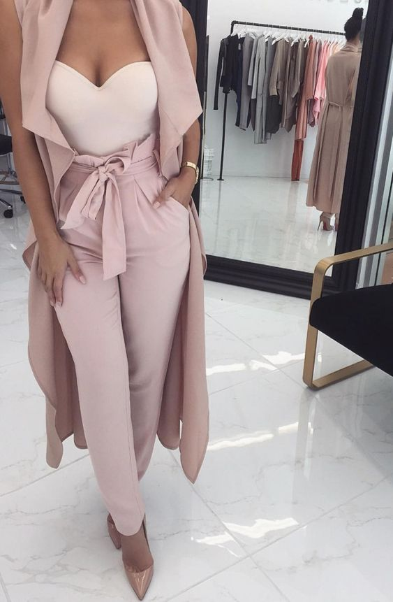 high waisted blush pants, a white strapless sweetheart neckline top, a long blush vest and nude heels