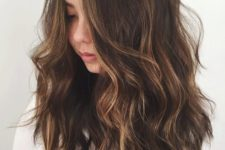 10 long dark wavy hair with subtle bronded and caramle highlights