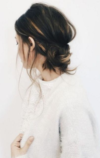a messy low bun, some hair down for an effortlessly chic look