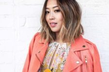11 a short dark wavy bob with bronde balayage higlhlights that create a volume