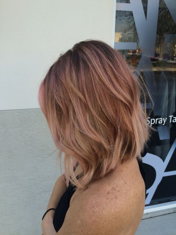 a textured bob with fair hair and rose gold balayage for a colorful touch