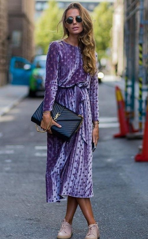 an ultraviolet polka dot velvet midi dress, blush sneakers and a large black bag