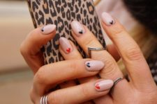 11 blush manicure with red and black little hearts for a girlish look