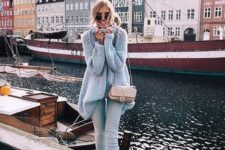 11 light denim, a grey chunky knit oversized sweater, white sneakers