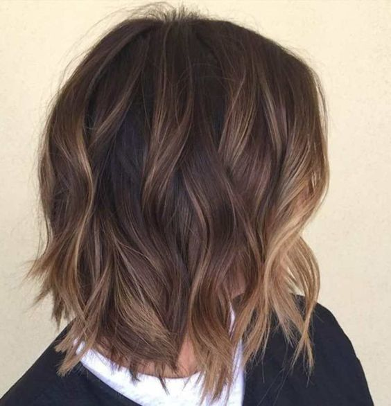 shaggy brown bob with subtle bronde balayage highlights for a dimension
