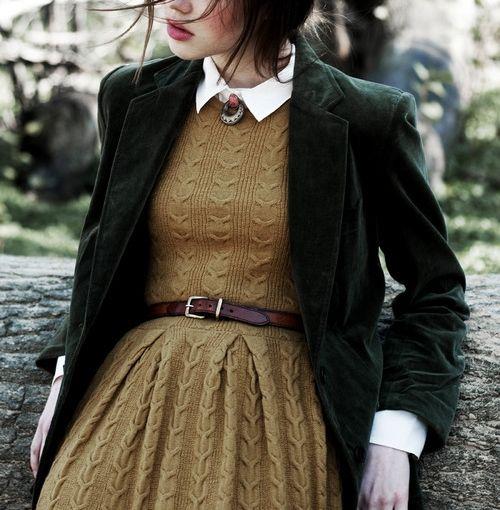 a mustard-colored sweater dress, a white shirt, a dark green velvet blazer