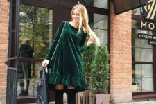12 an emerald velvet dress, stockings, grunge boots and a black leather jacket