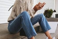 12 blue cropped jeans, a cable knit neutral sweater and white sneakers for a comfy look