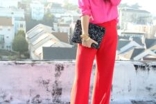 12 red wide pants, a pink shirt, a bold clutch and a statement chain necklace