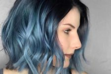 13 a black roots and metallic blue ombre with waves