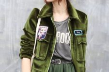 13 a green velvet pilot jacket, a forest green midi pleated skirt and a printed tee