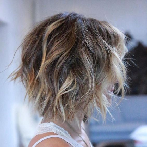 a short bob with shaggy layers done in blonde is great for creating a texture and volume