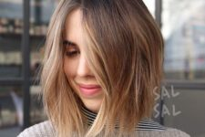 13 a short shaggy bob with blonde balayage to make the hair look more eye-catching