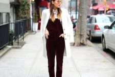 13 a white shirt, a burgundy velvet overall, white flats and a coat
