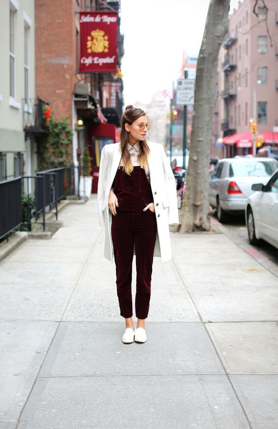 a white shirt, a burgundy velvet overall, white flats and a coat