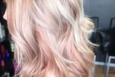 13 blonde hair with rose gold highlights looks very girlish