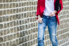 13 blue ripped jeans, black strappy heels, a printed tee and a red blazer
