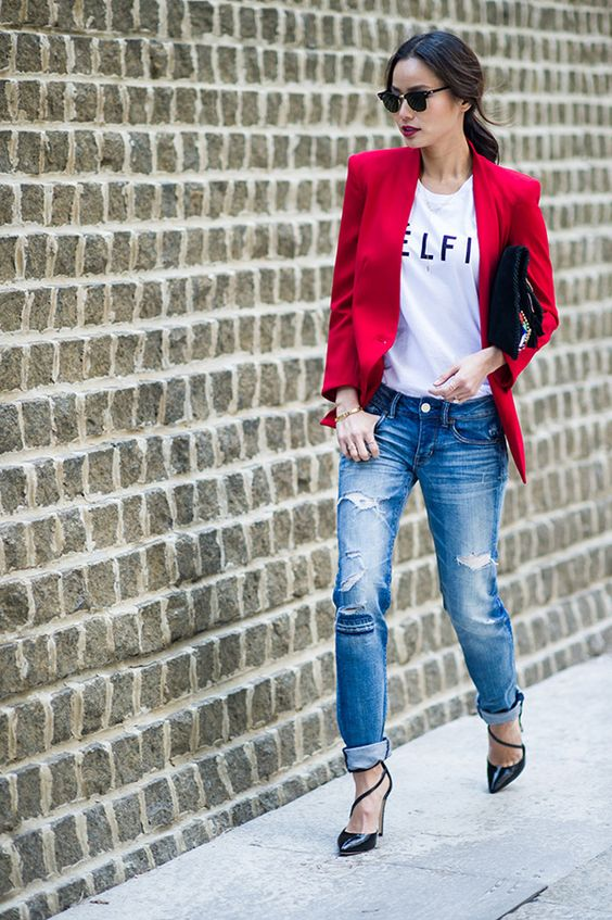 blue ripped jeans, black strappy heels, a printed tee and a red blazer